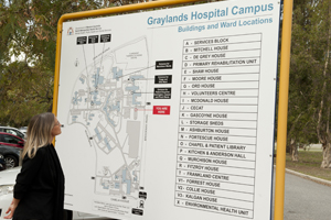 Lady looking at a campus map